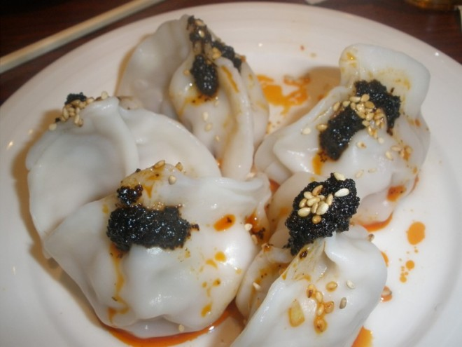 Steamed Pork and Cabbage Dumplings with Spicy Sesame Chili Sauce